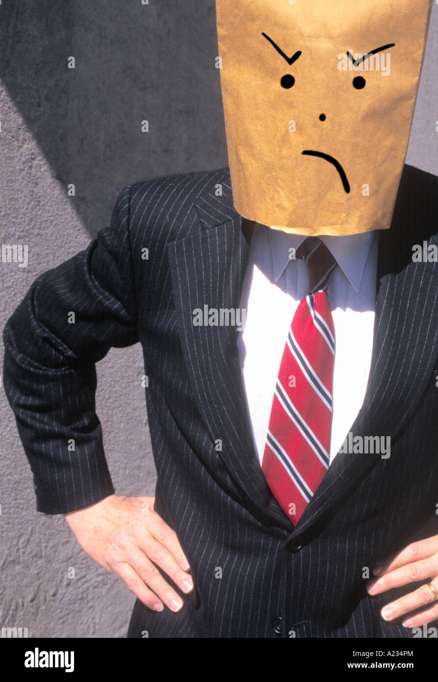 Businessman With Brown Paper Bag Over His Head Frowning Dissatisfied - Stock Image