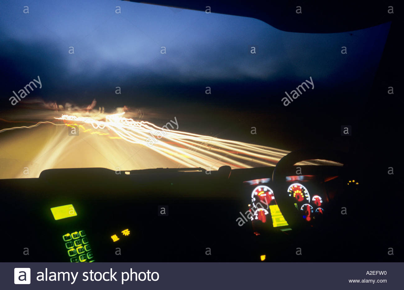 driving vehicle night lights as seen from a lorry (truck) cab / driving concept Stock Photo