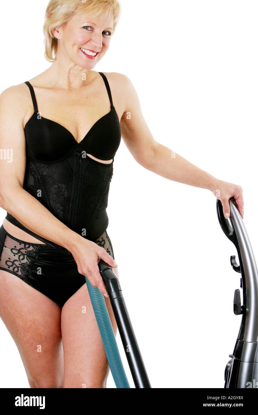 mature woman in body sculpting underwear hoovering model released