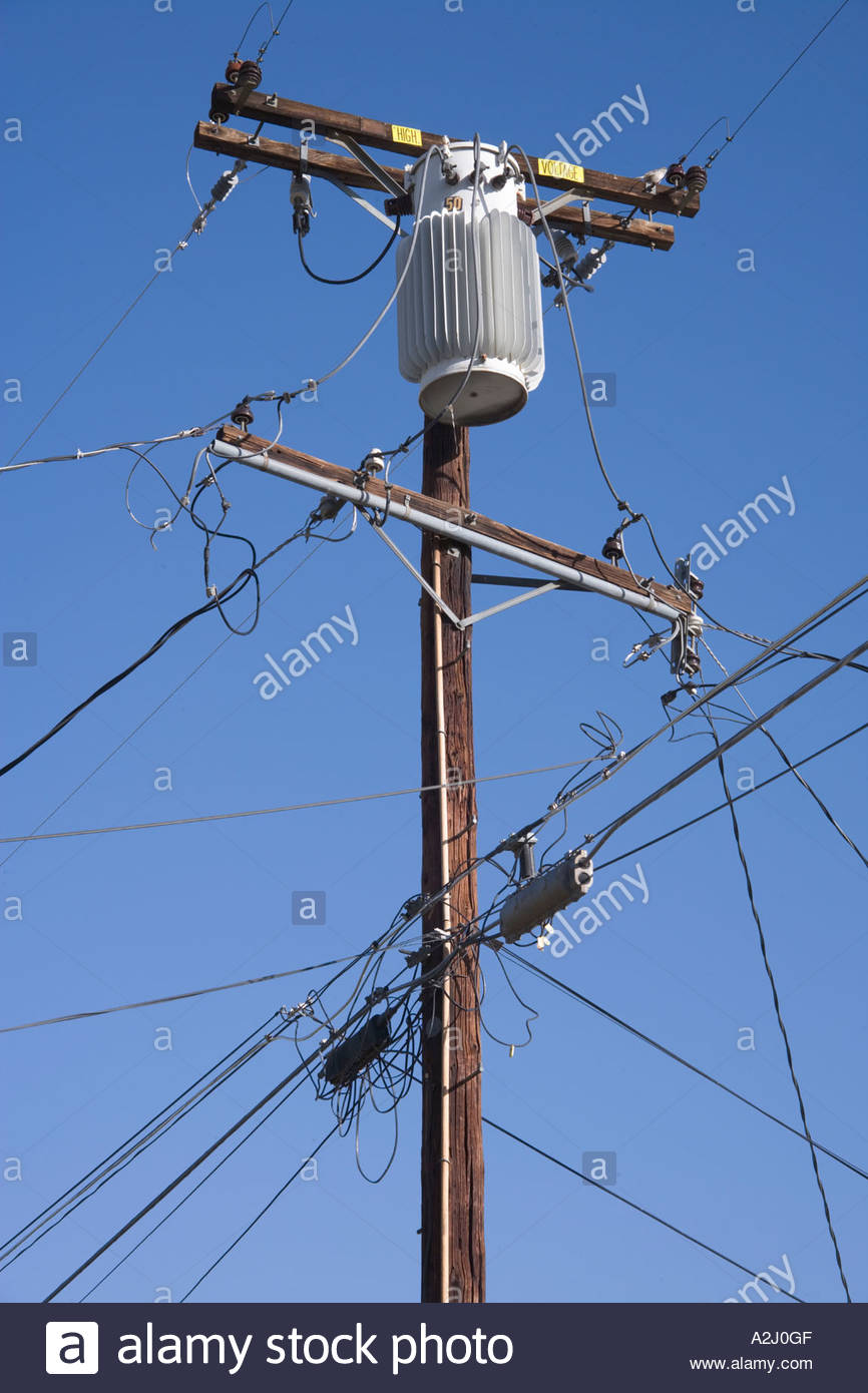 a typical American electricity and phone wire pole in a residential ...