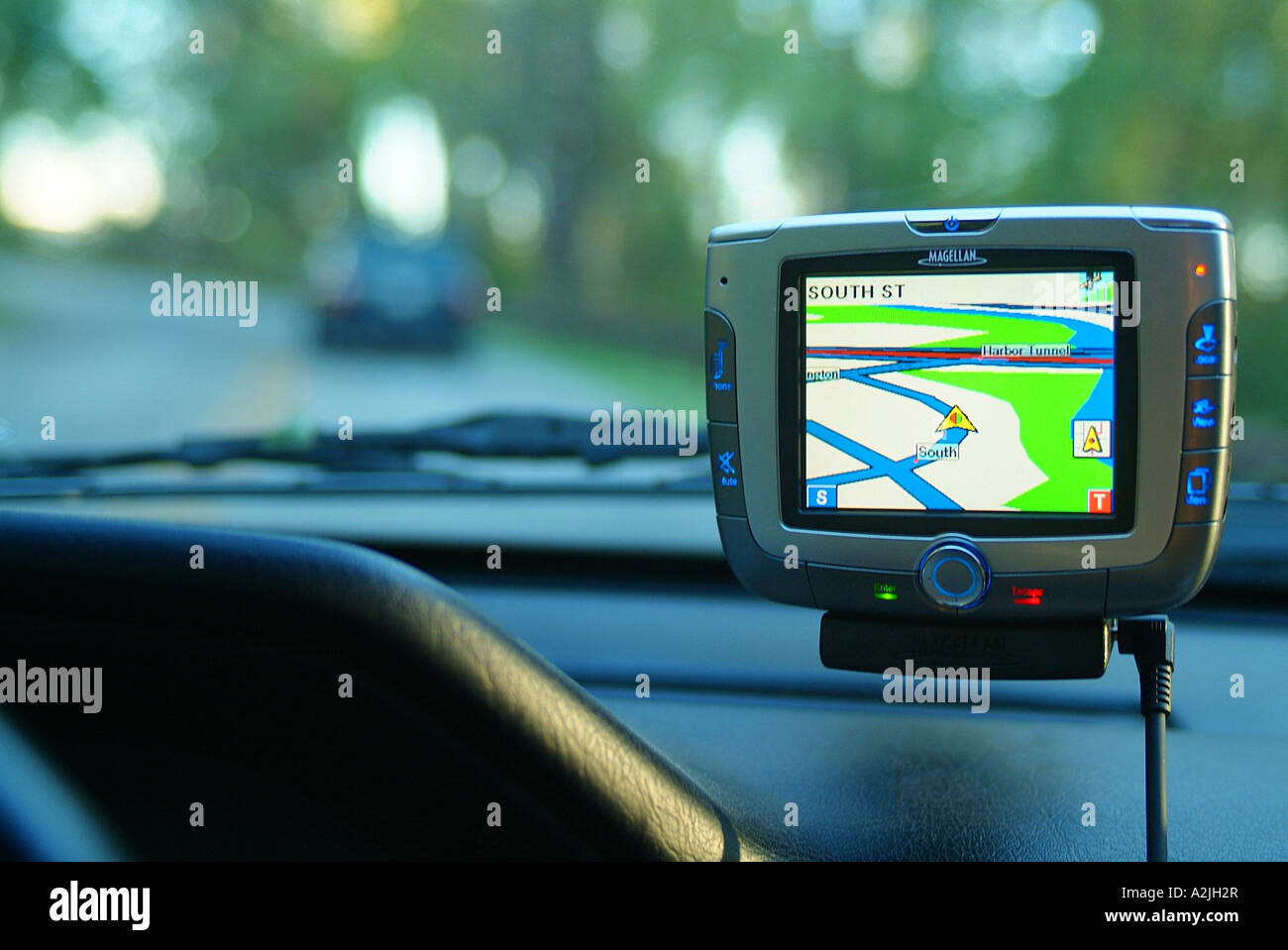 a-magellan-roadmate-6000t-gps-unit-helps-the-driver-find-streets-and-A2JH2R.jpg