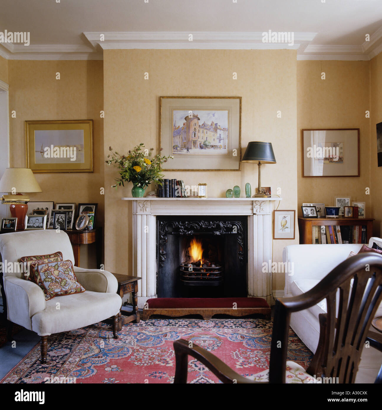 English Country Style Living Room With Mantel Piece, Arm Chair And Rug