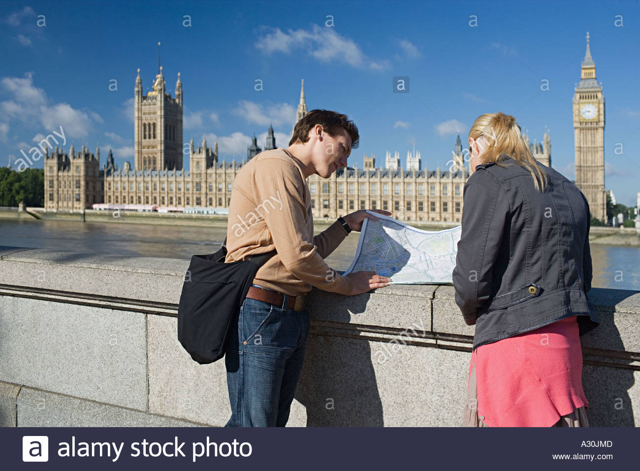 Couple standing near Houses of Parliament - Stock Image