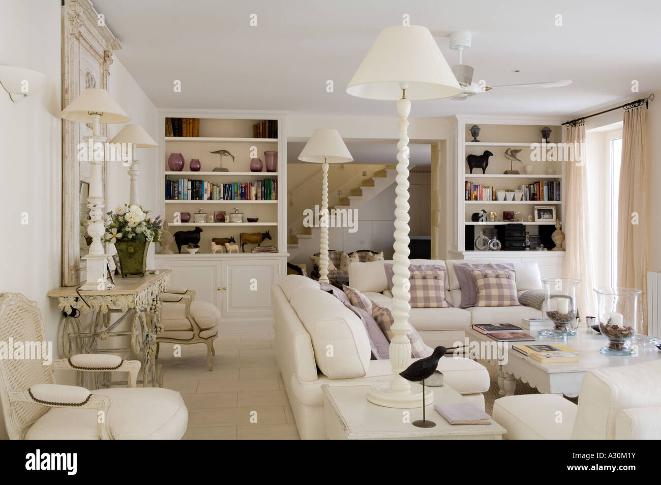 White Living Room With Matching Bookcases And Lamps
