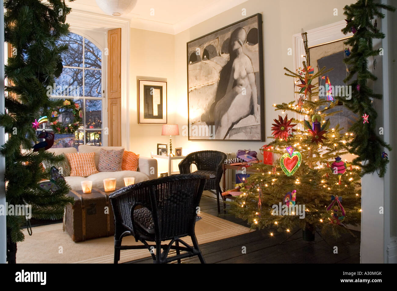 Christmas tree and decorations in the living room of a Georgian townhouse, London - Stock Image