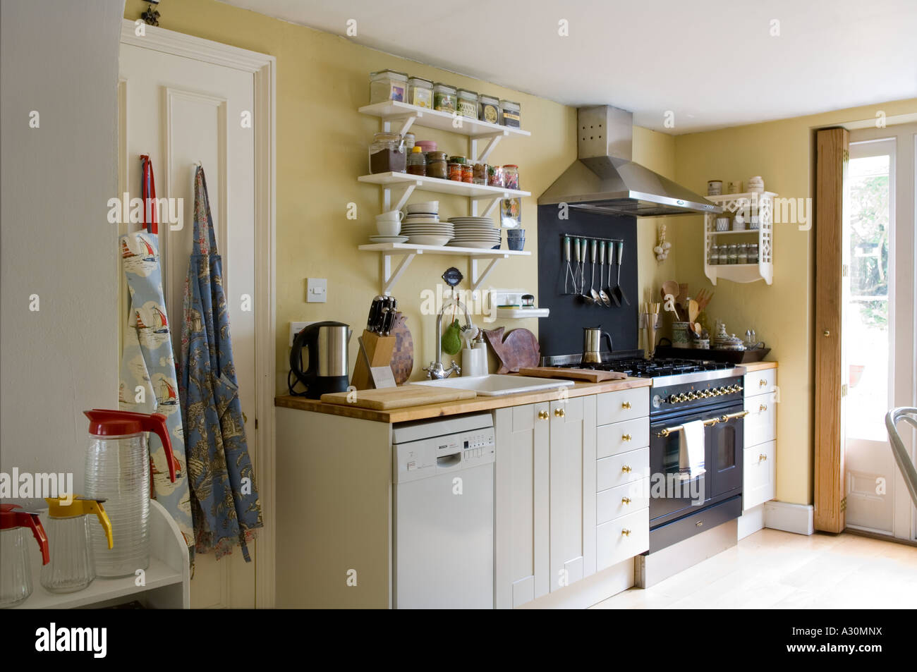Kitchen of a Victorian house in London home to a jewelery designer - Stock Image