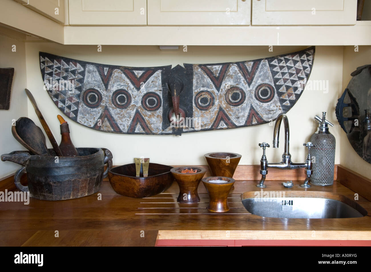 Kitchen sink area with African art Stock Photo: 10632819 - Alamy