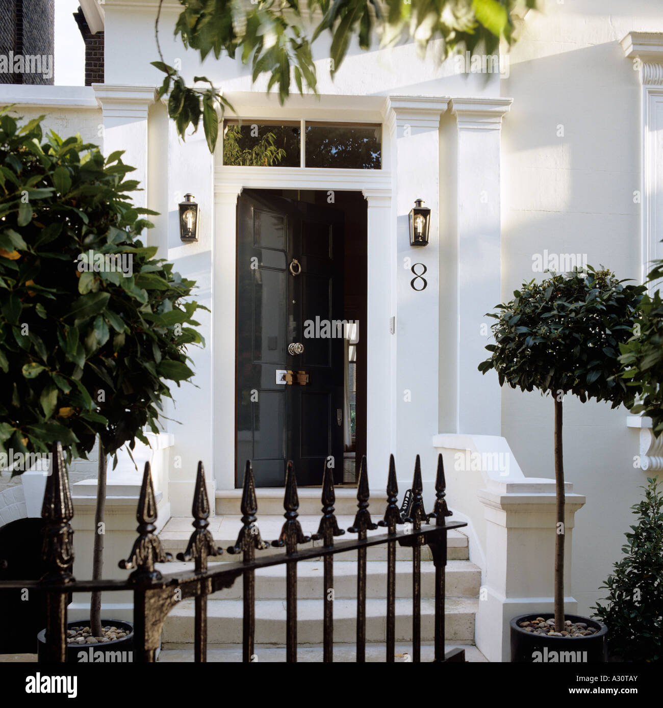 entrance of an elegant Victorian London townhouse - Stock Image