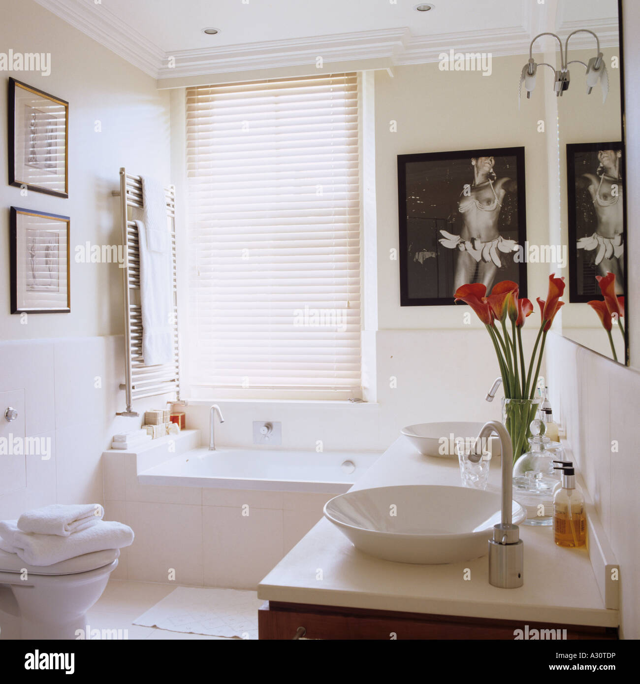 white modern bathroom in a London townhouse - Stock Image