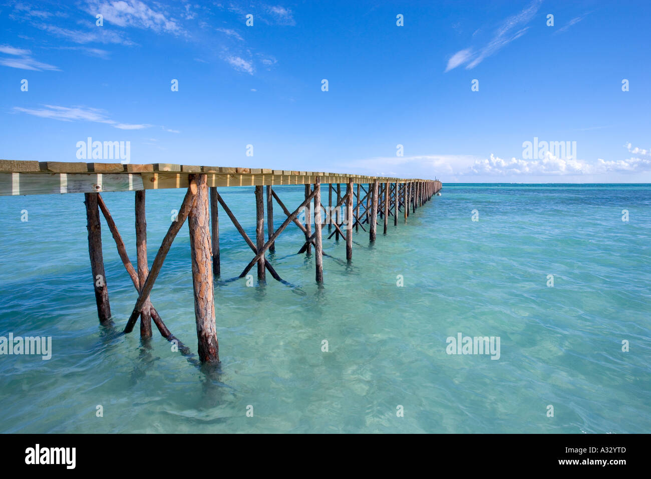 Bahamas, Abaco.  Long public dock stretching out into the ocean. - Stock Image