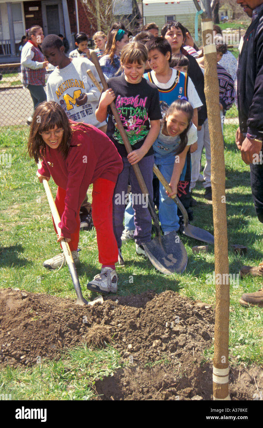 Children Plant Tree on Earth Day - Stock Image