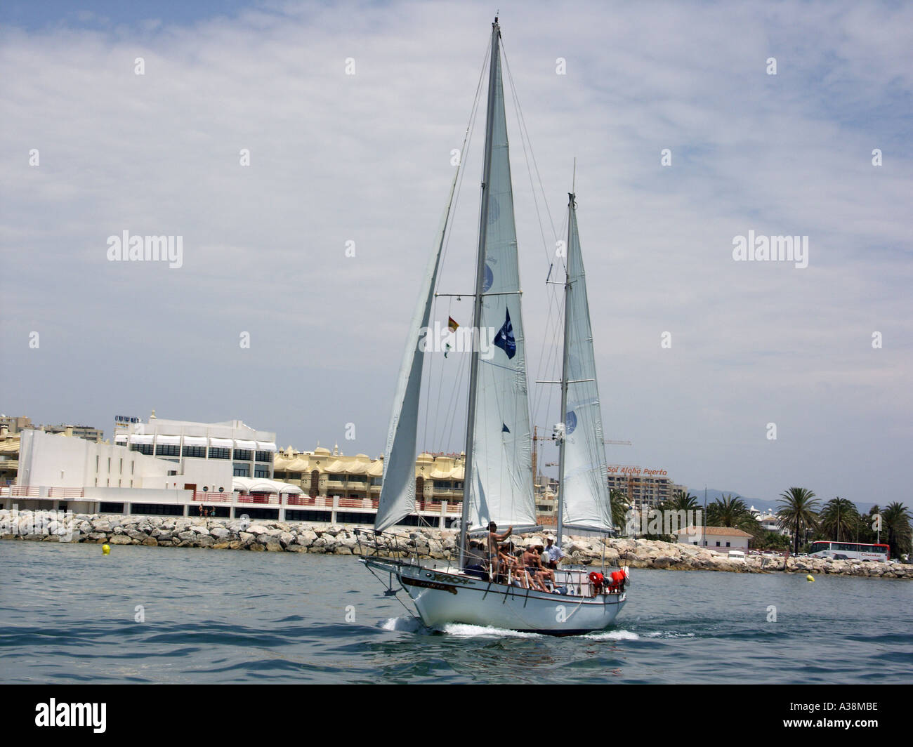 Yacht Sailing in the Mediterranean Sea off the coast of Benalmadena Costa del Sol Spain  yacht yachts sail sails - Stock Image