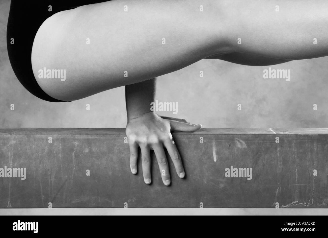 gymnast on beam - Stock Image