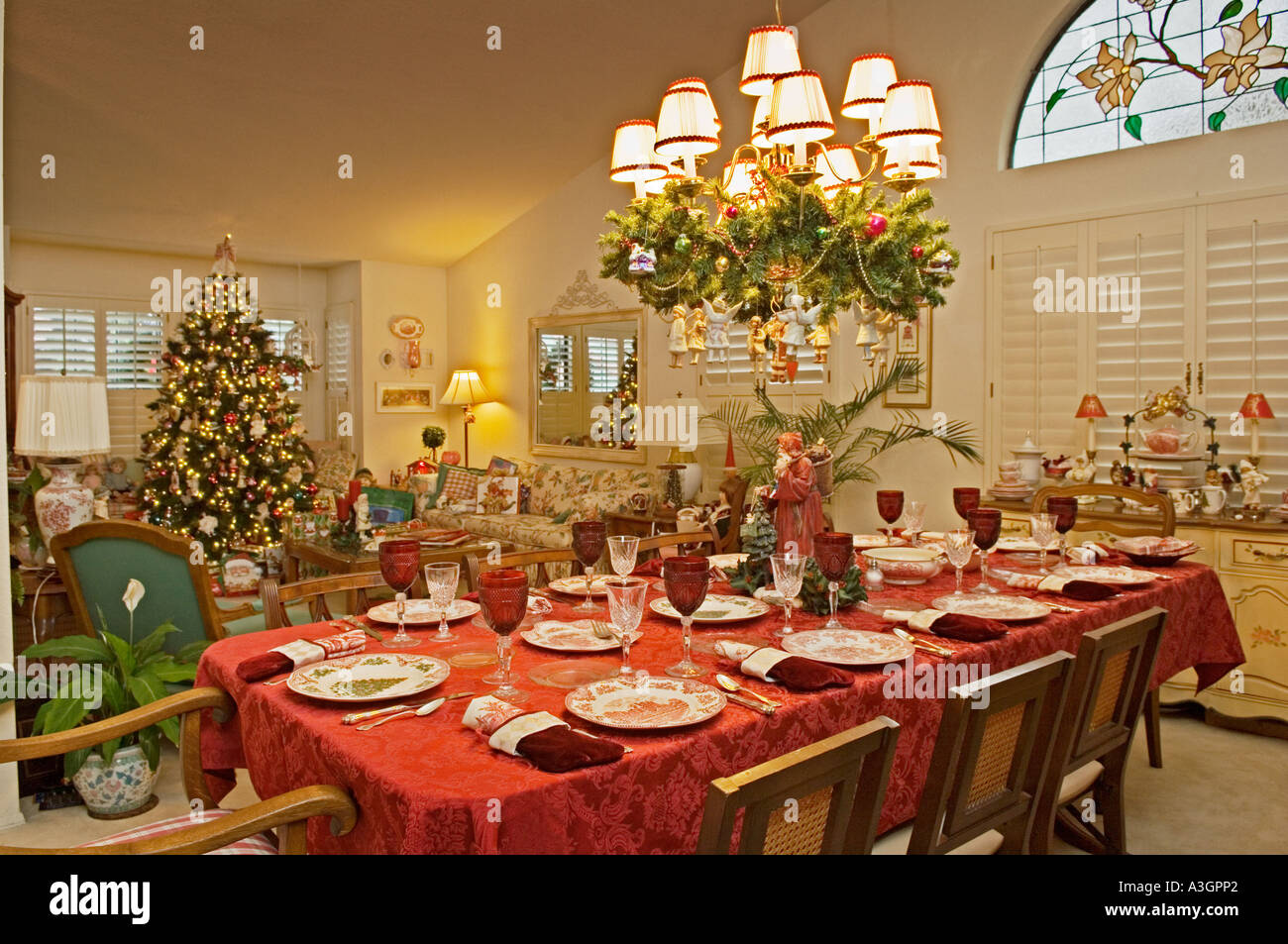 Dining room table set for Christmas dinner in living room of upscale house in southern California & Dining room table set for Christmas dinner in living room of upscale ...