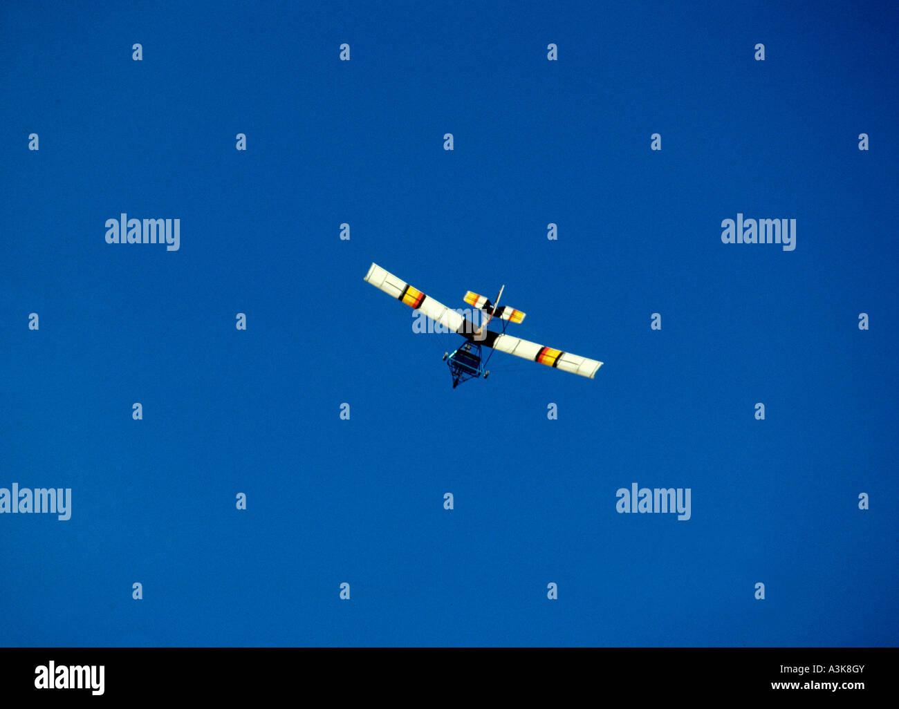Microlite lightweight single engine aircraft against a blue sky - Stock Image