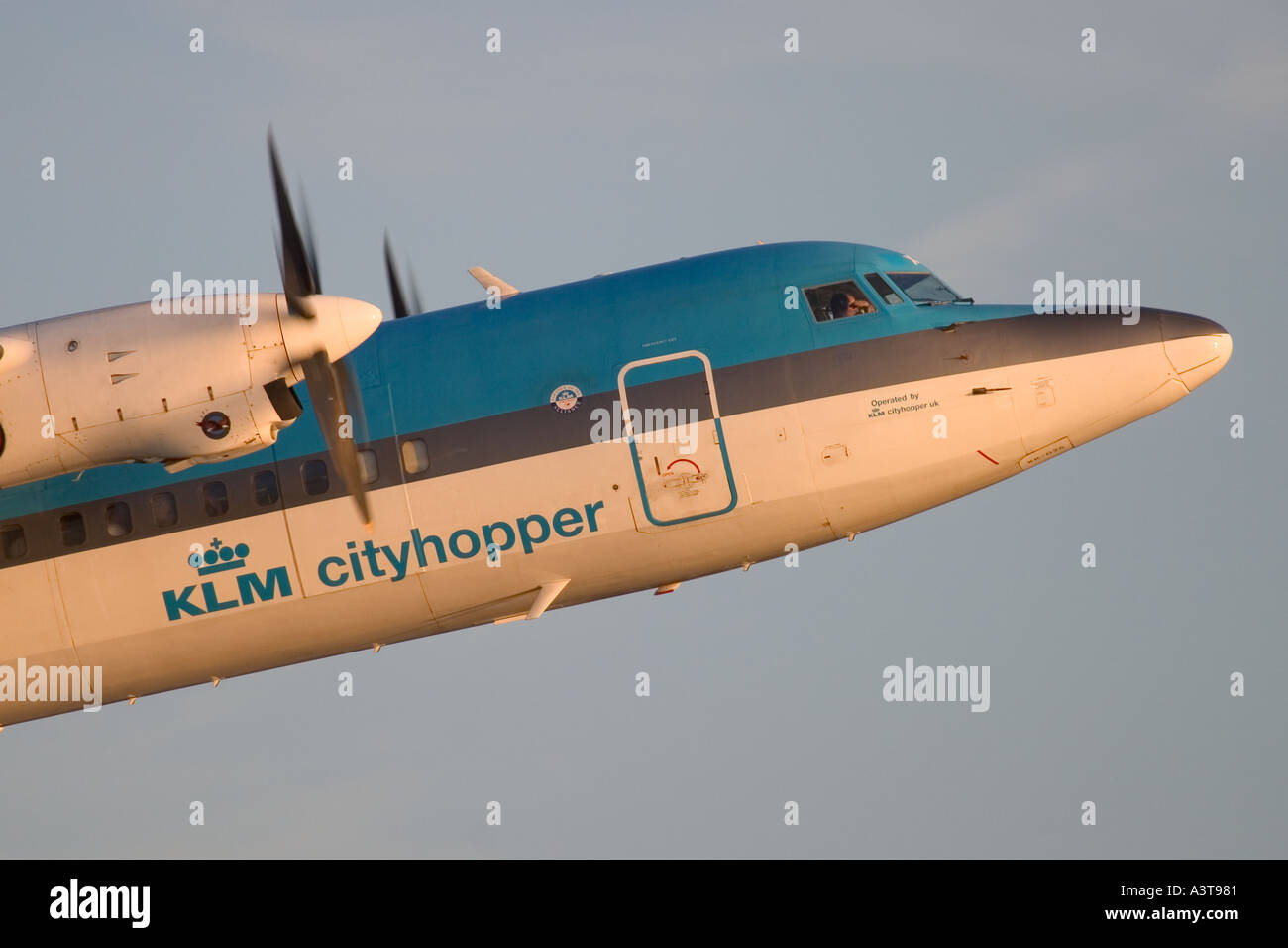 Commercial aircraft Fokker 50 KLM taking off at London City Airport, England, UK - Stock Image