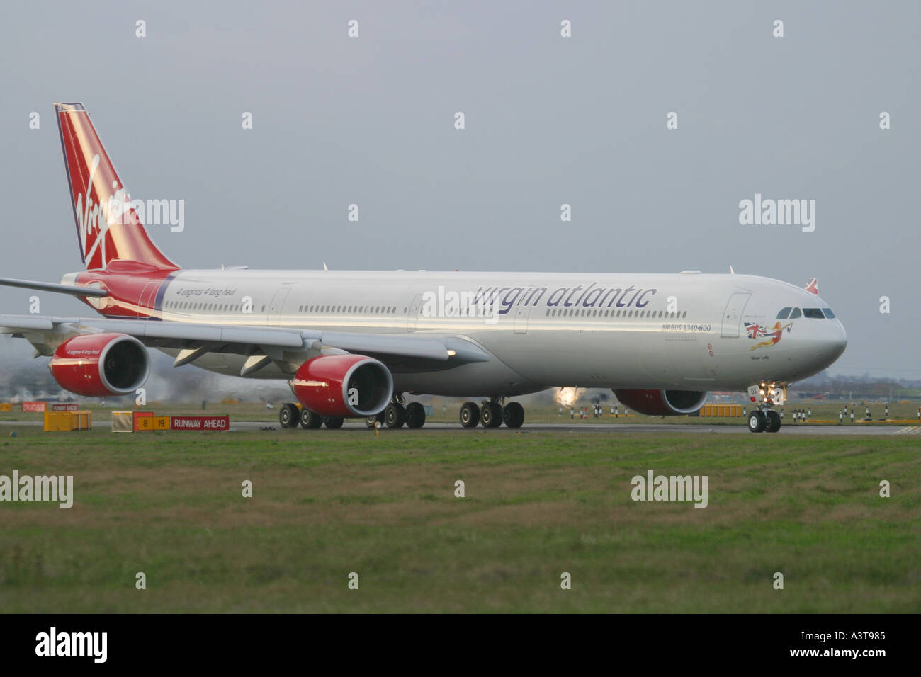 Commercial aircraft Airbus A340 642 Virgin Atlantic Airways preparing for departure at London Heathrow Airport - Stock Image