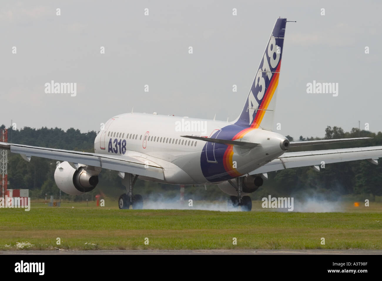 Smallest Airbus A318 landing at Farnborough airshow after display 2004 - Stock Image