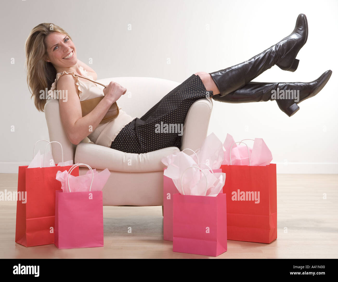 Woman relaxing after shopping - Stock Image