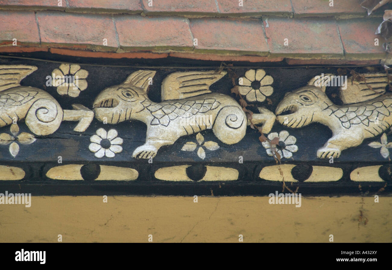 A frieze of dragon like creatures decorates a house in Smarden Smarden Kent England UK 21 July 2006 - Stock Image