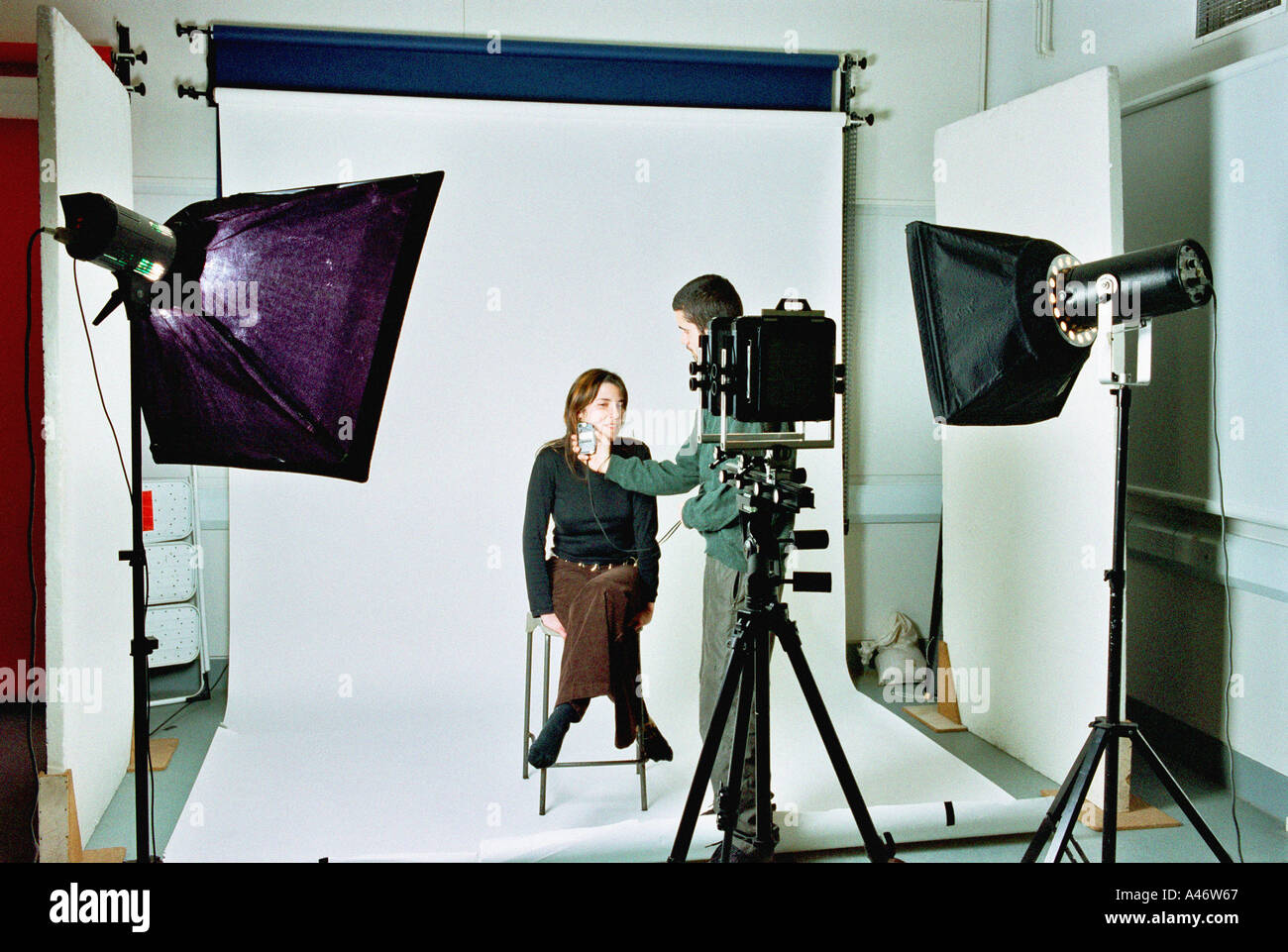 Photographer in studio - Stock Image