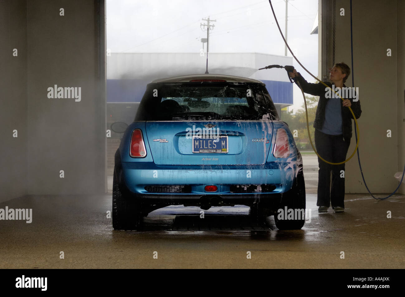 Woman washing a mini cooper s at a do it yourself car wash stock woman washing a mini cooper s at a do it yourself car wash solutioingenieria Gallery