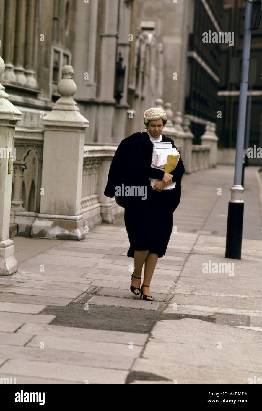 A female barrister wearing a wig   gown walking outside the High Court ca6a3a52e074