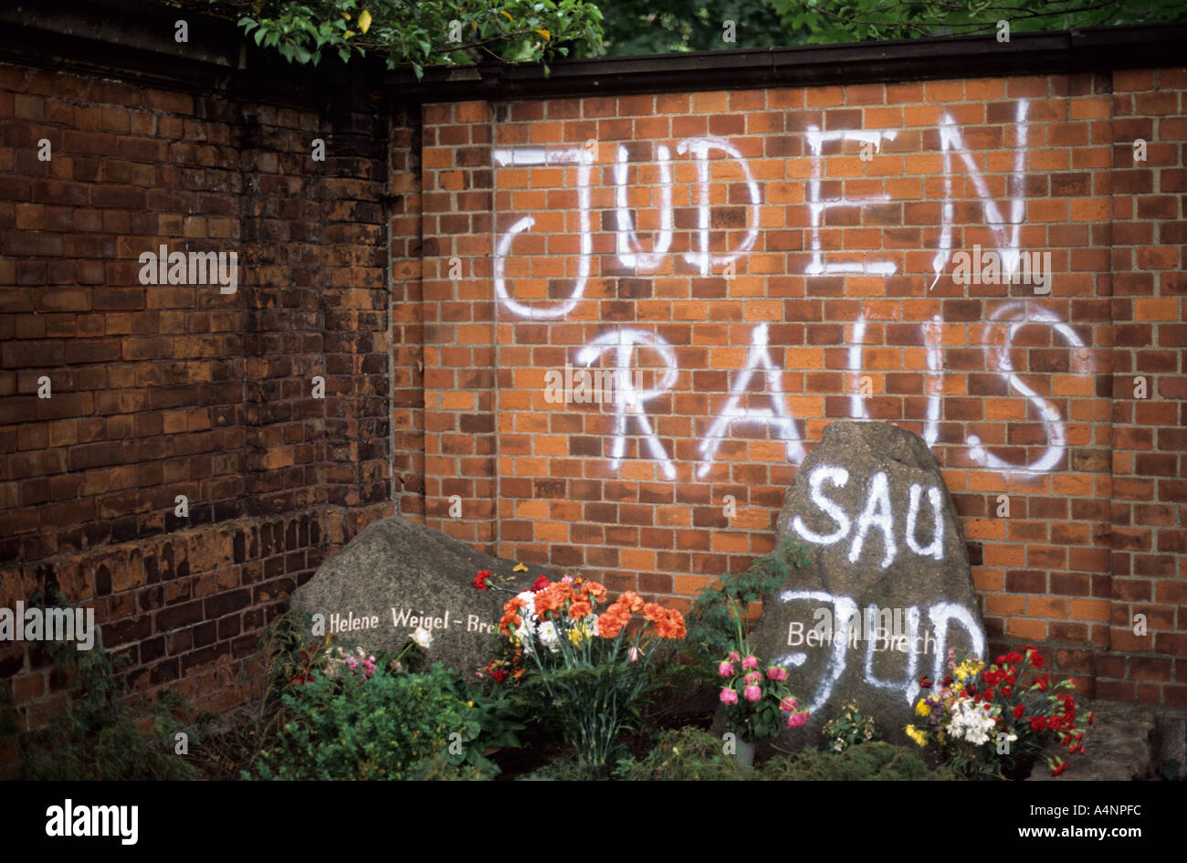 The graves of Bertolt Brecht and his wife Helene Weigel smeared with anti semitic graffiti. Dorotheenstadt cemetery Stock Photo