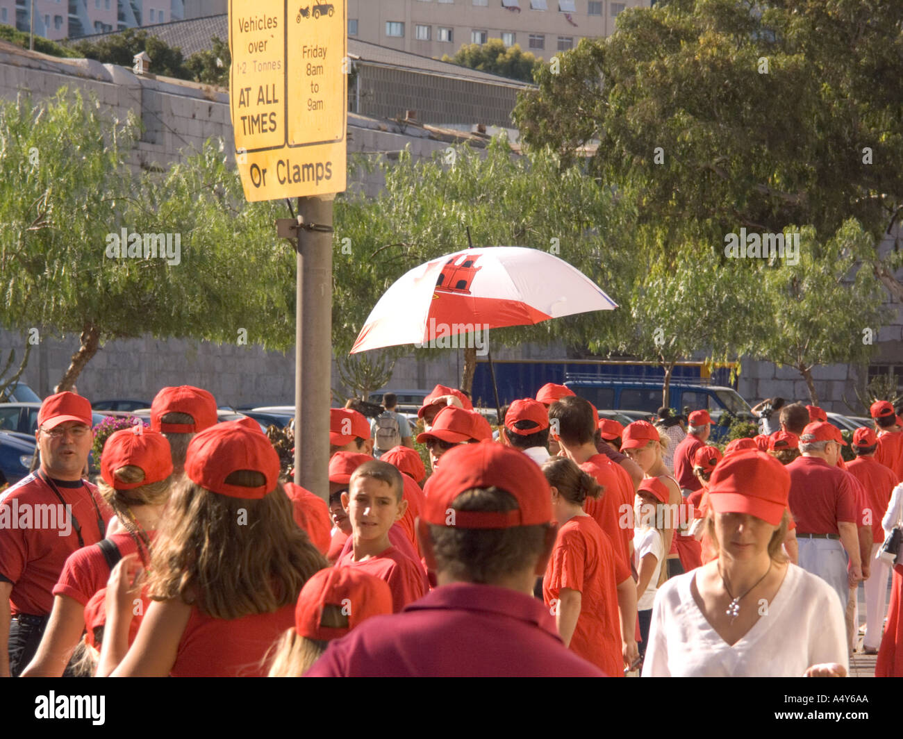 On the morning of the 4th August 2004 some 17 000 people dressed in the red and white colours of Gibraltar linked - Stock Image