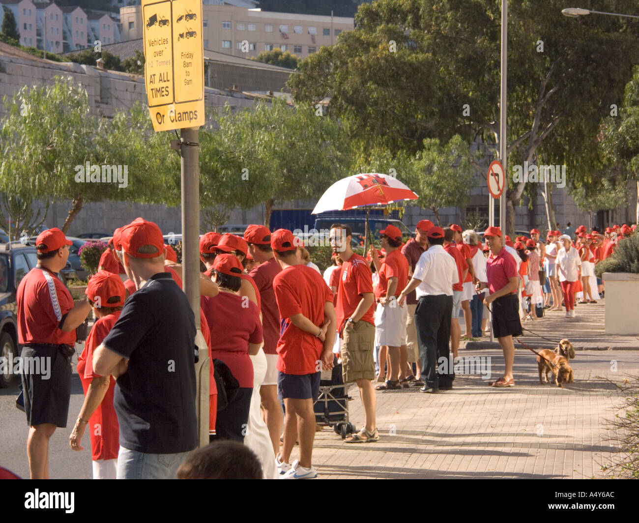 Gibraltar Tercentenary Celebrations human chain hold held link linked hands enjoy Gibraltar Tercentenary Celebrations - Stock Image