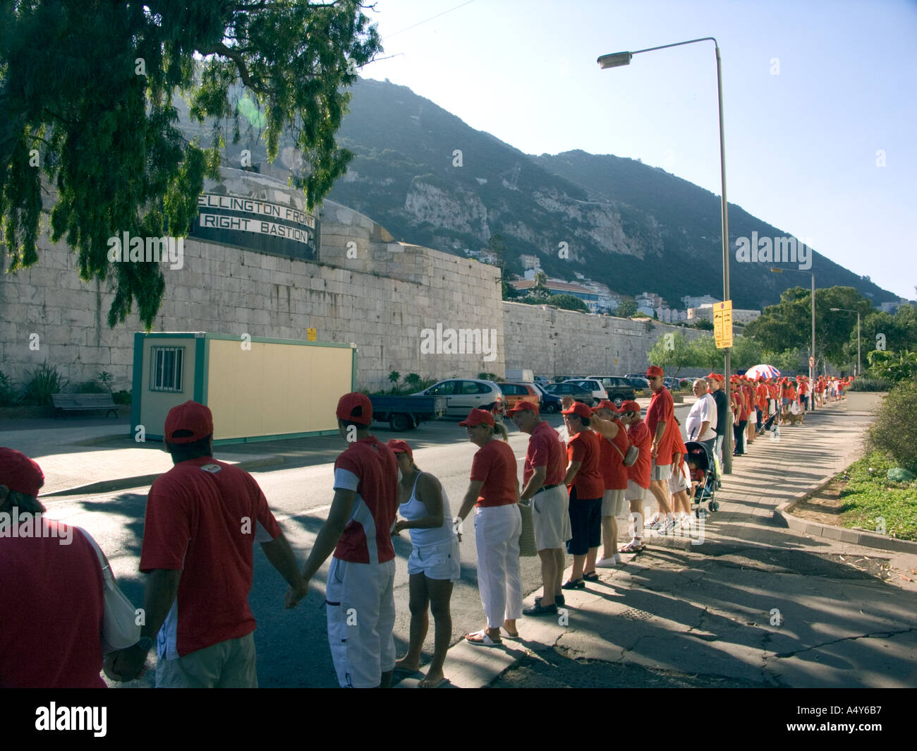 Holding hands around the rock Gibraltar Tercentenary Celebrations human chain hold held link linked hands enjoy - Stock Image