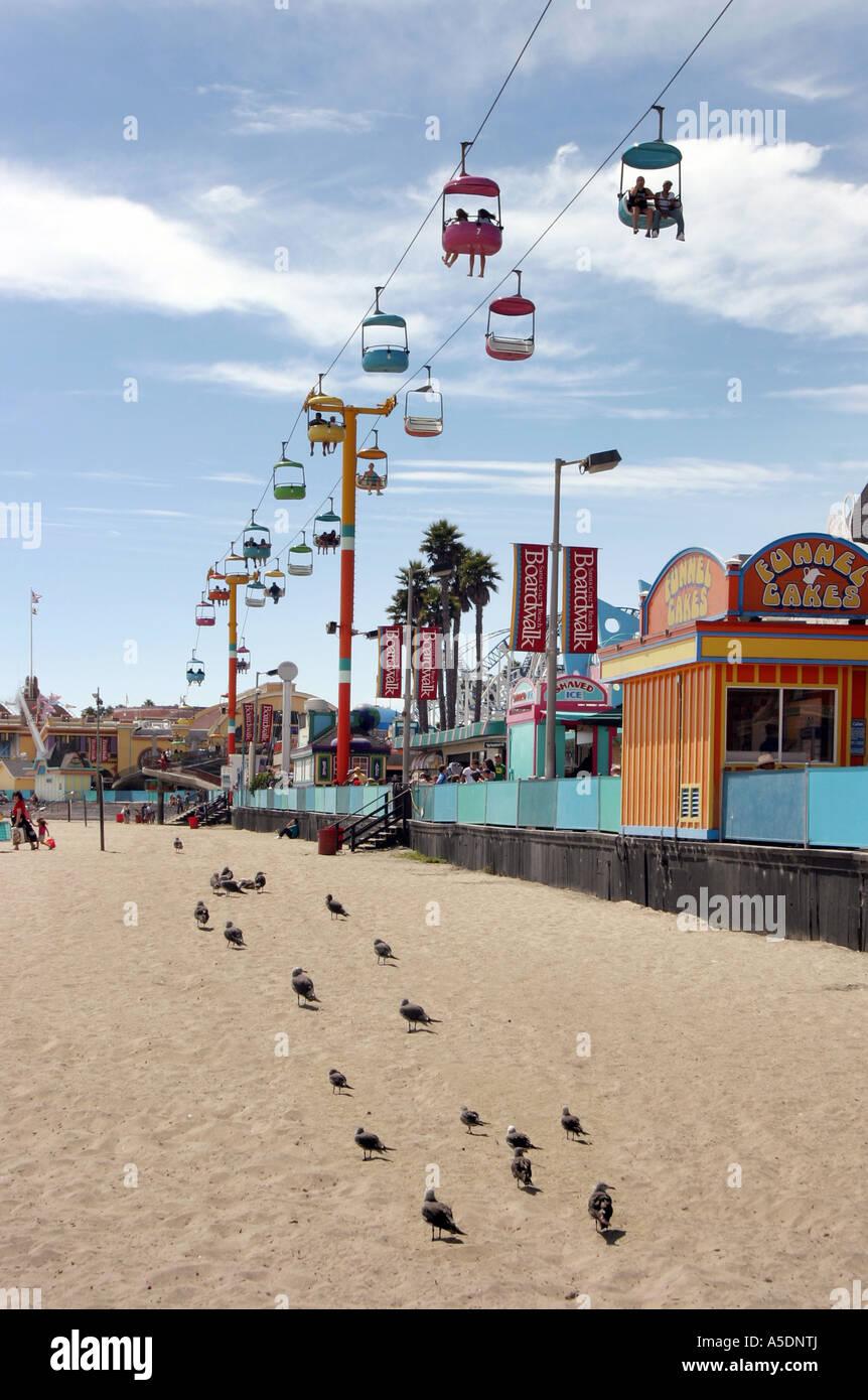 the-overhead-cable-car-and-pigeons-the-boardwalk-santa-cruz-california-A5DNTJ.jpg