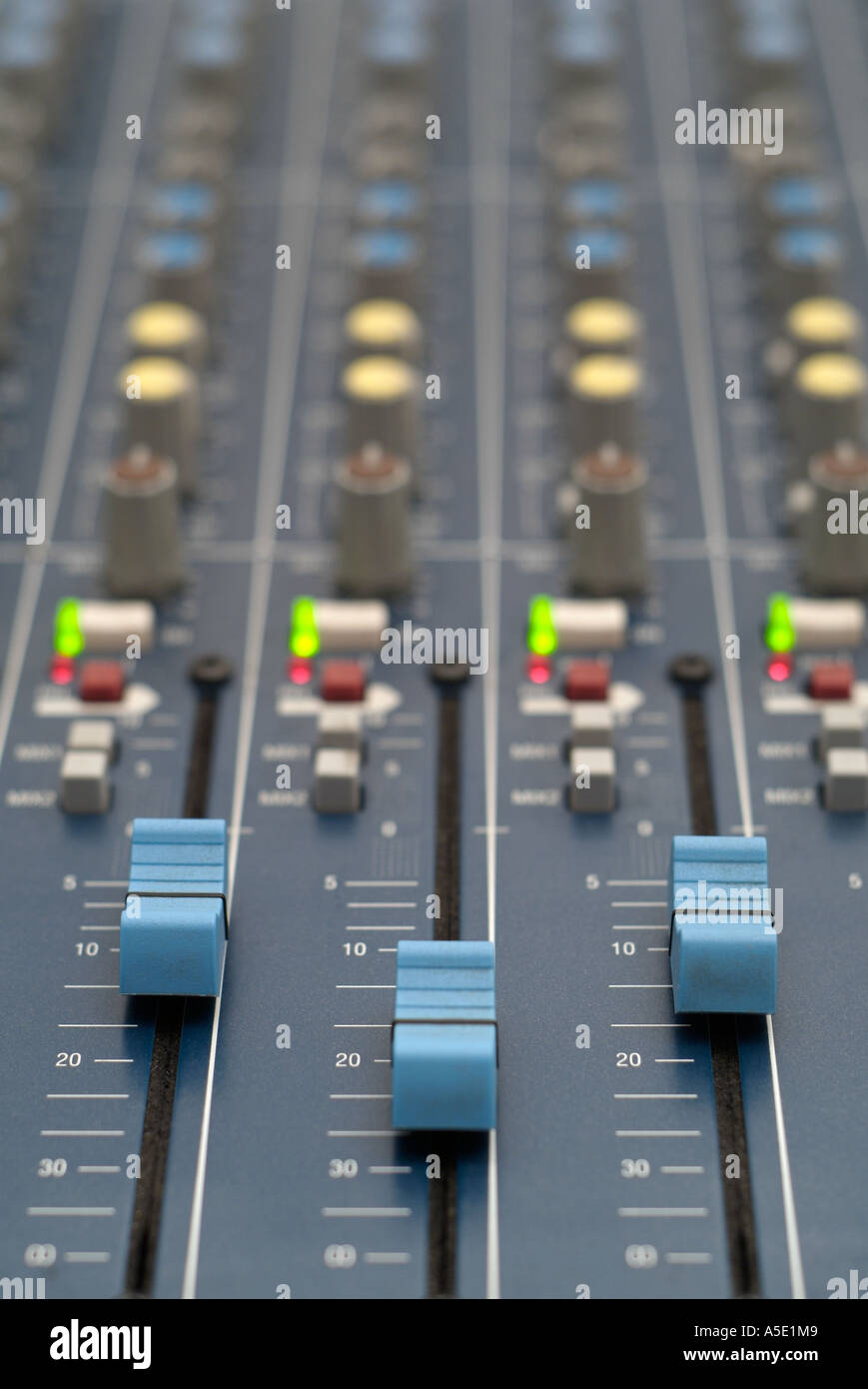 electronic mixing desk controls in a recording studio close up