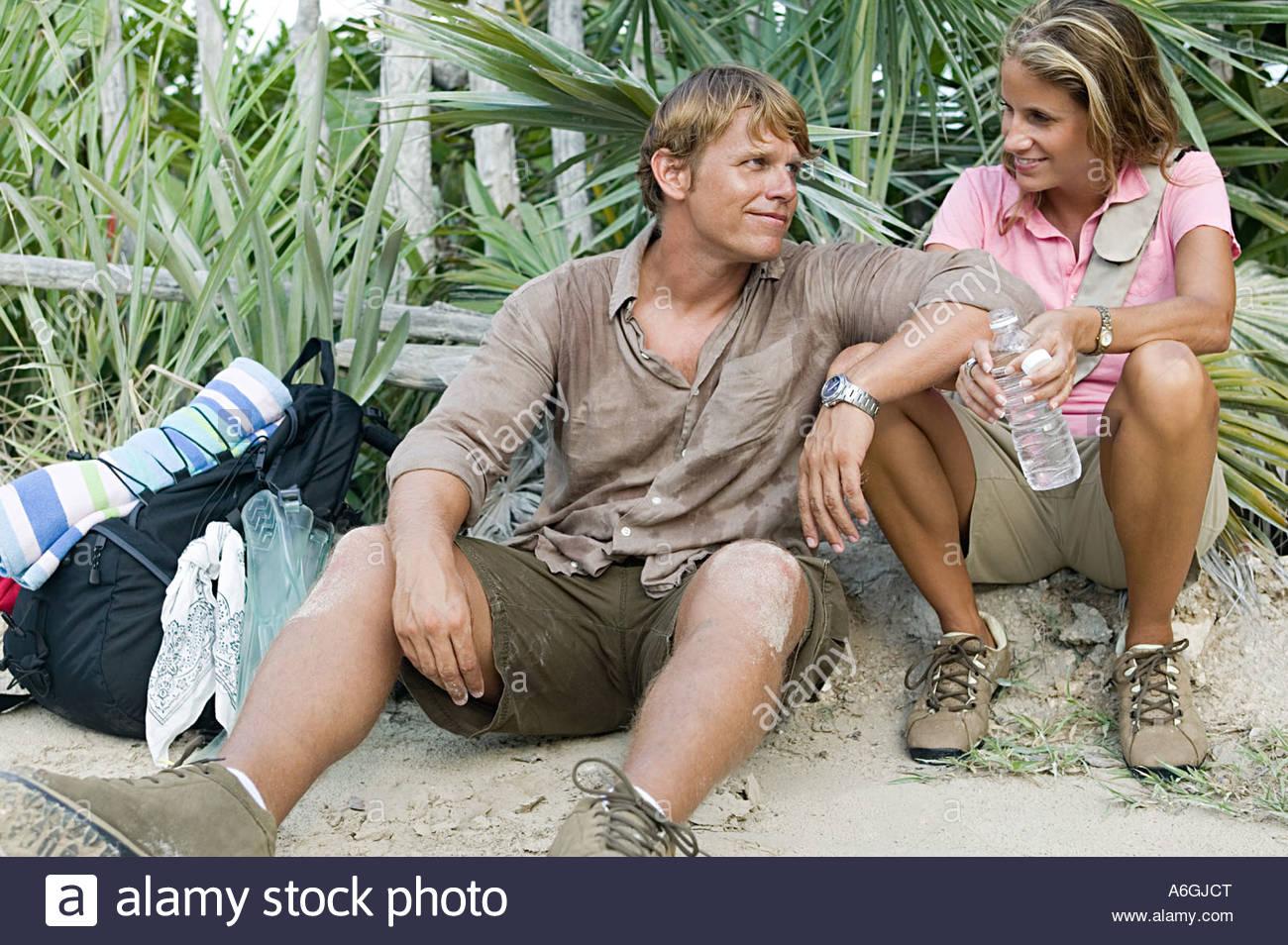 Couple taking a break on trek - Stock Image