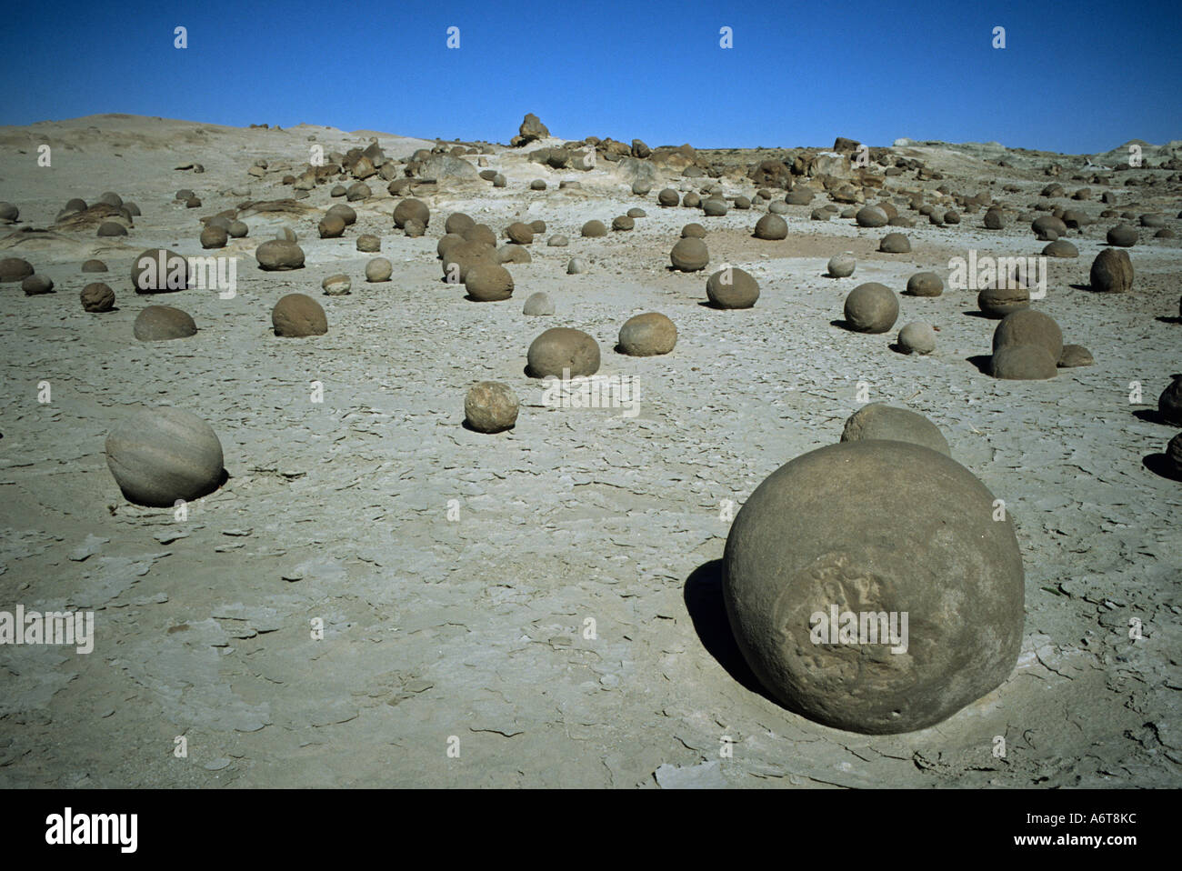 round stone balls formed from the dry desert a strange phenomenon in North Argentina - Stock Image