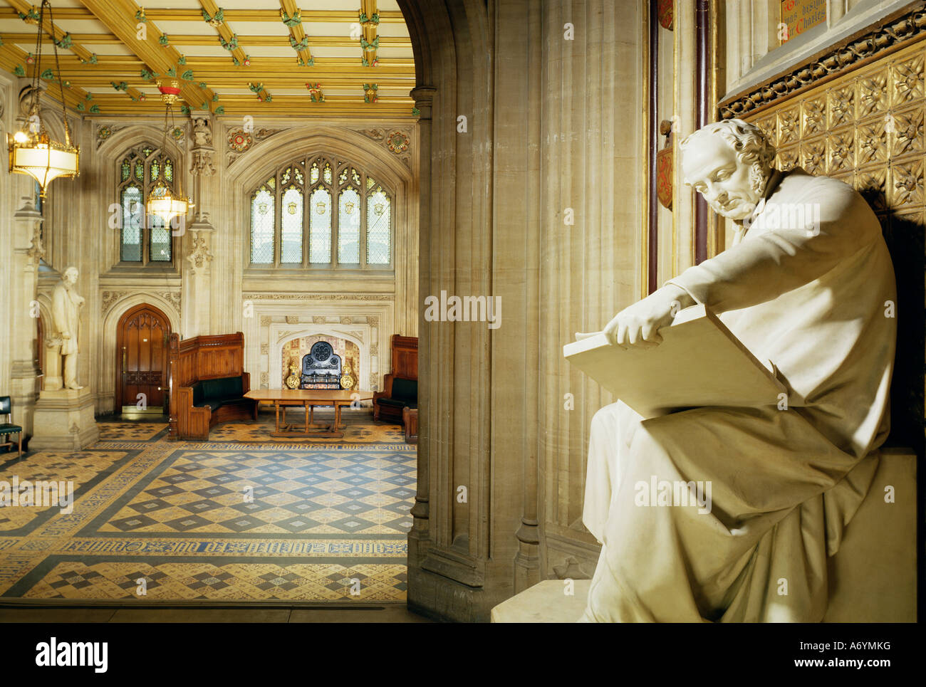 Lower waiting hall with statue of the architect Barry House of Commons Houses of Parliament Westminster London England - Stock Image