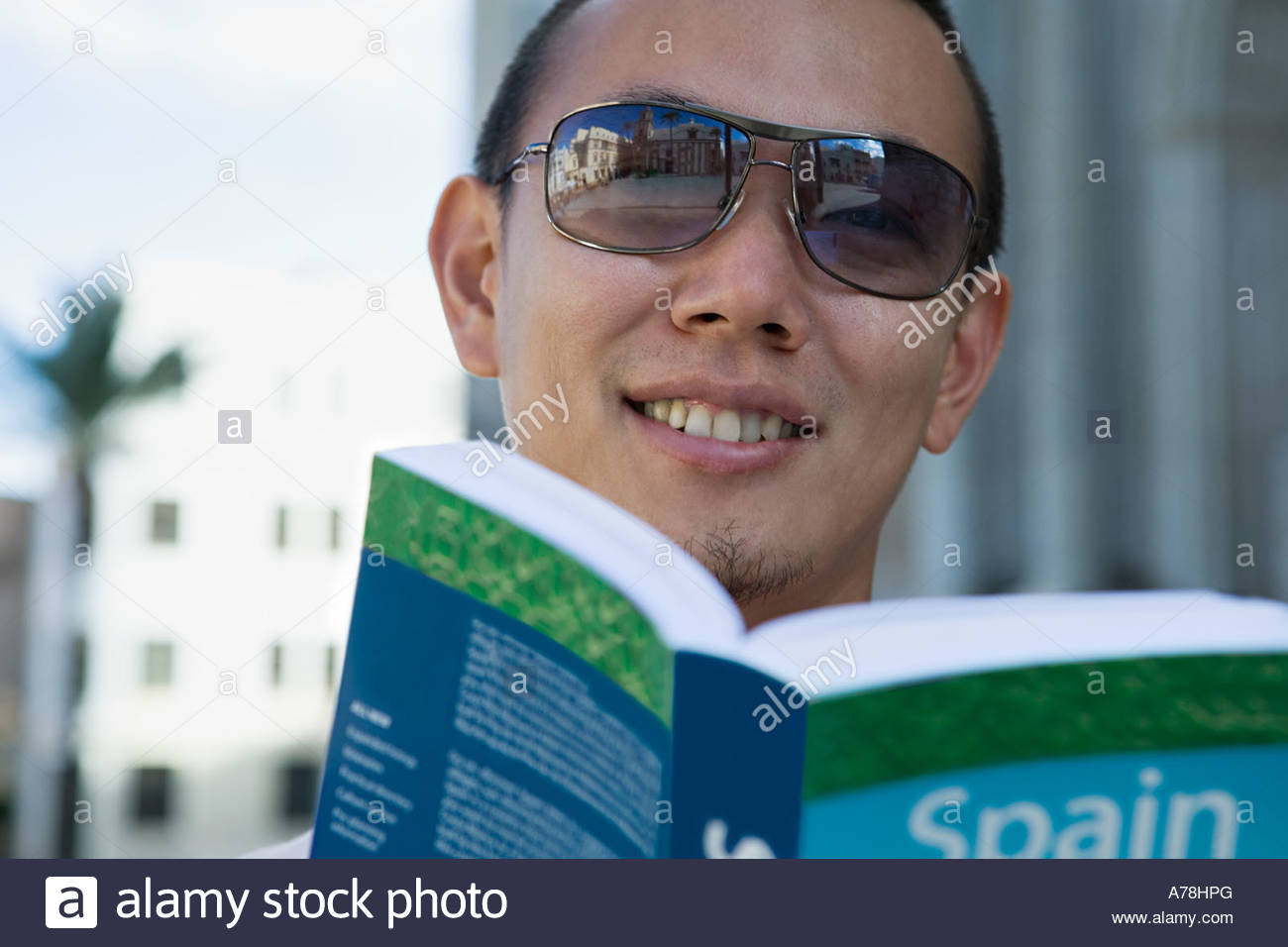 Man with tour guide - Stock Image