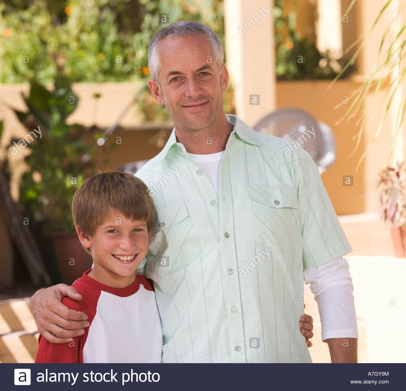 Portrait of a father with his young son - Stock Image
