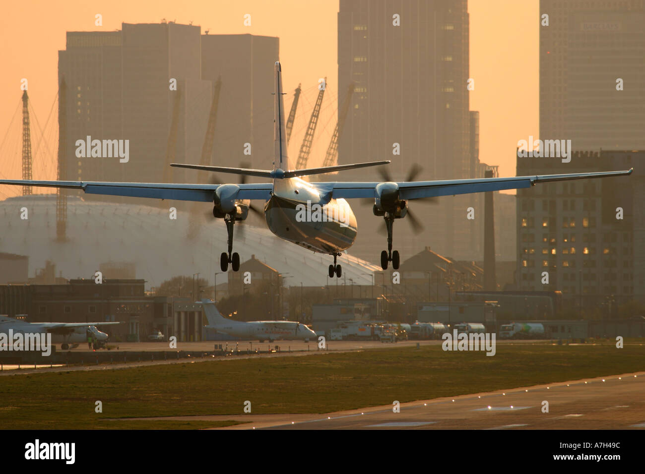 Fokker 50 KLM UK Cityhopper London City Airport Millenium Dome in the background - Stock Image