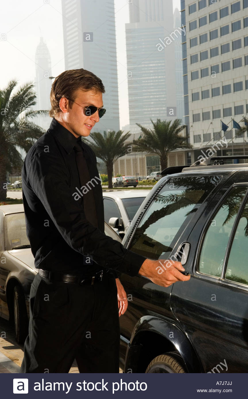 A wealthy man locking his car - Stock Image