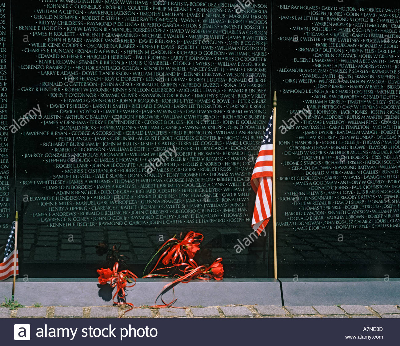 Names of war dead and missing in action etched on the Vietnam Veterans Memorial Wall in Washington DC USAStock Photo
