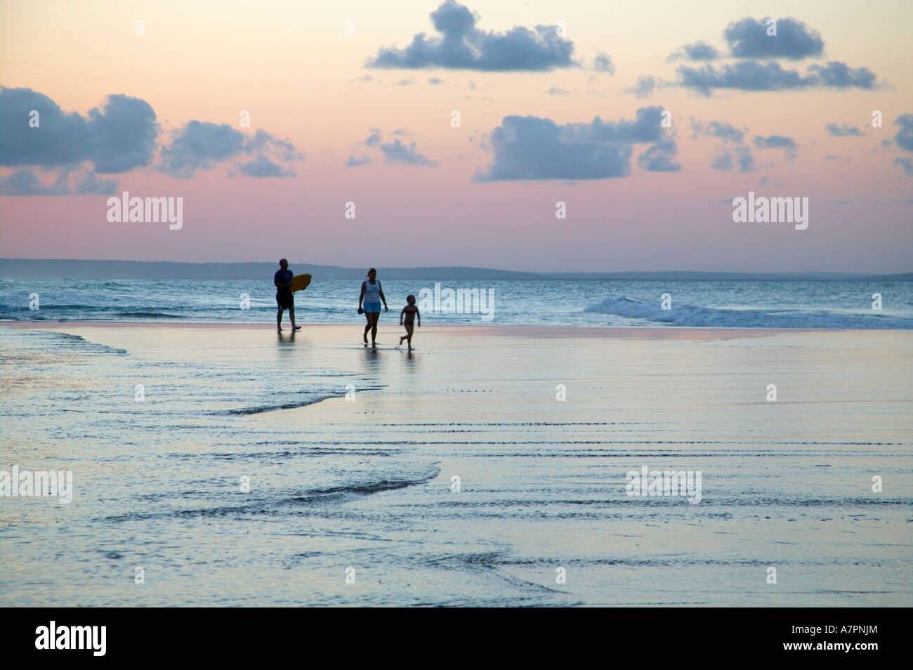 A family walking on the beach in Mozambique coast at dusk Barra Mozambique - Stock Image