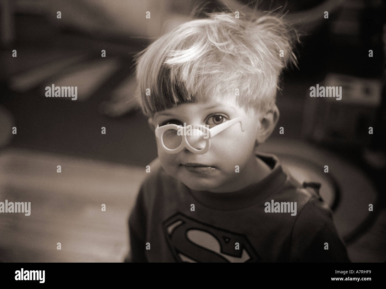 Small boy with toy glasses on face - Stock Image
