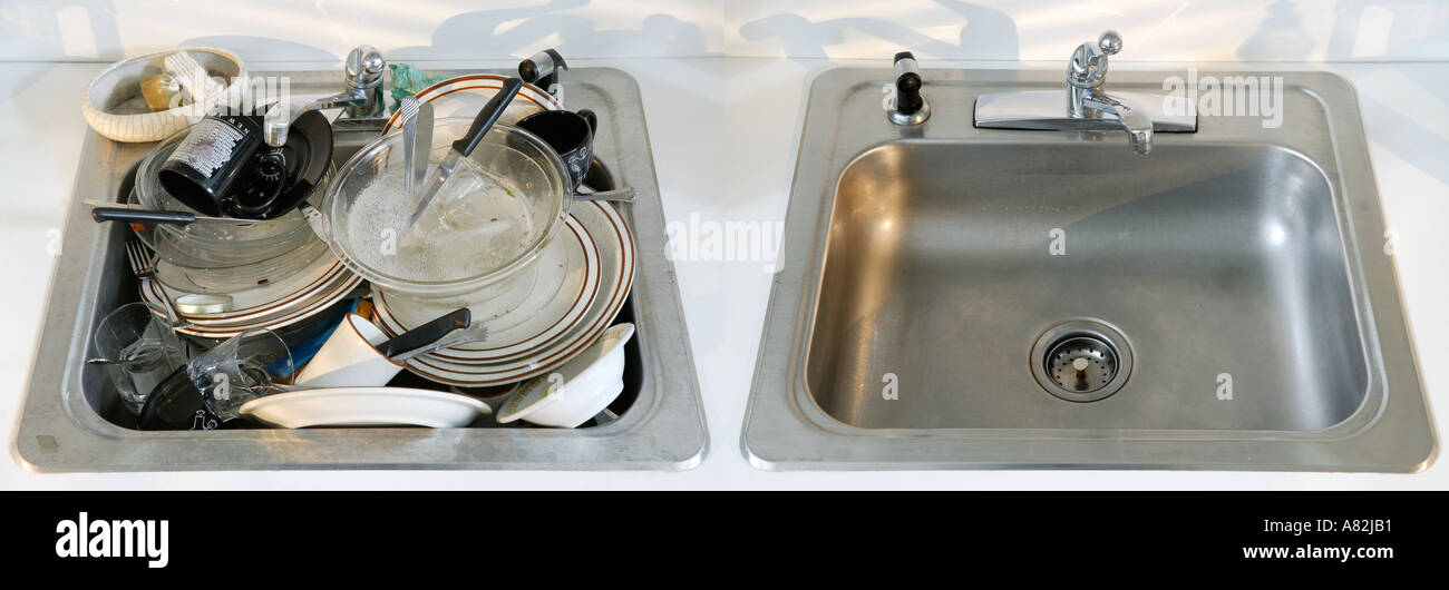 Dirty and clean kitchen sinks next to each other Stock Photo ...
