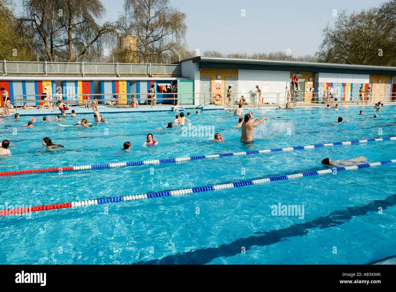 People enjoying sunny afternoon London Fields LIDO London Borough of Hackney outdoor swimming pool Stock Photo