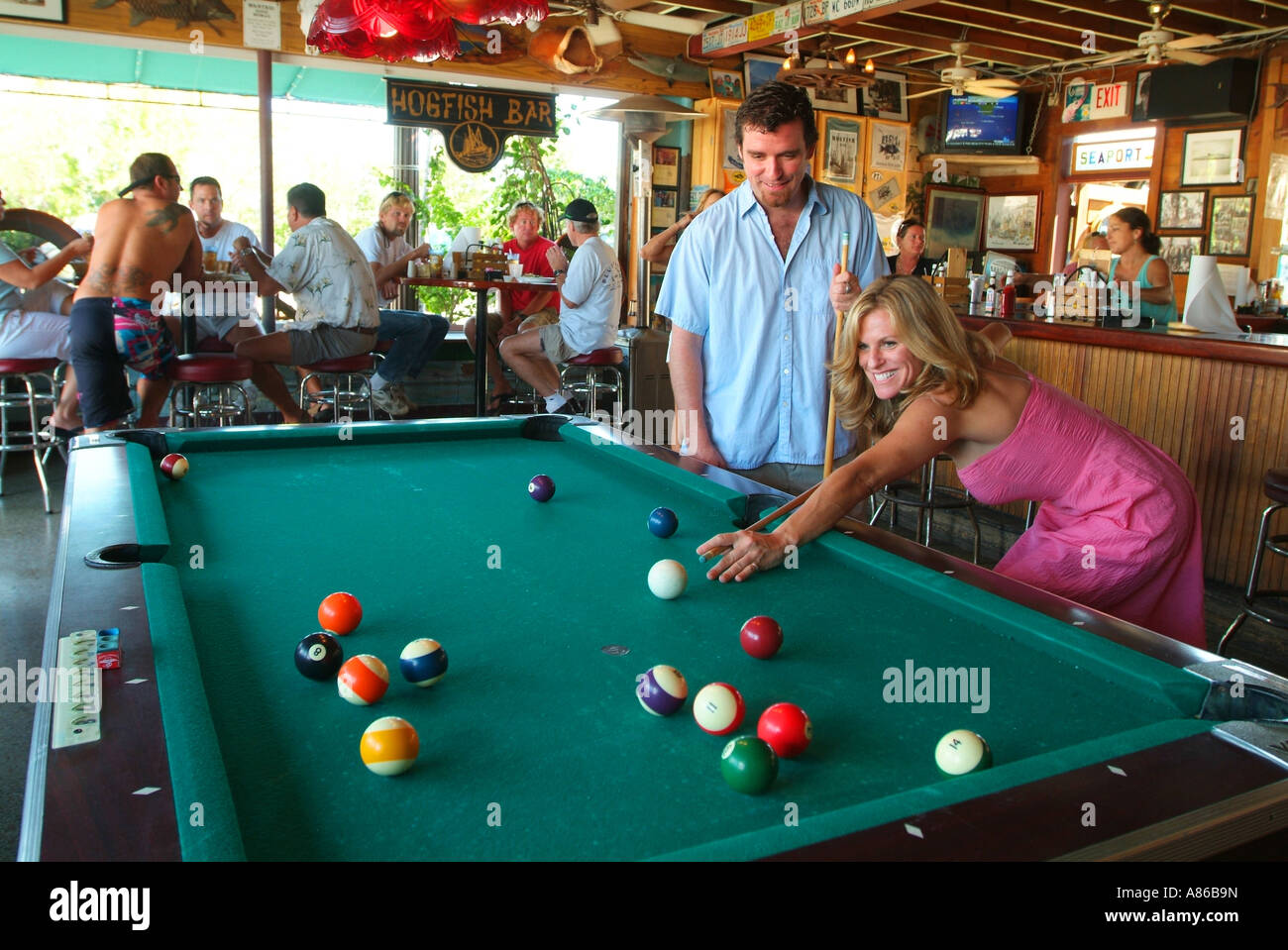 a-couple-plays-pool-at-the-hogfish-bar-a