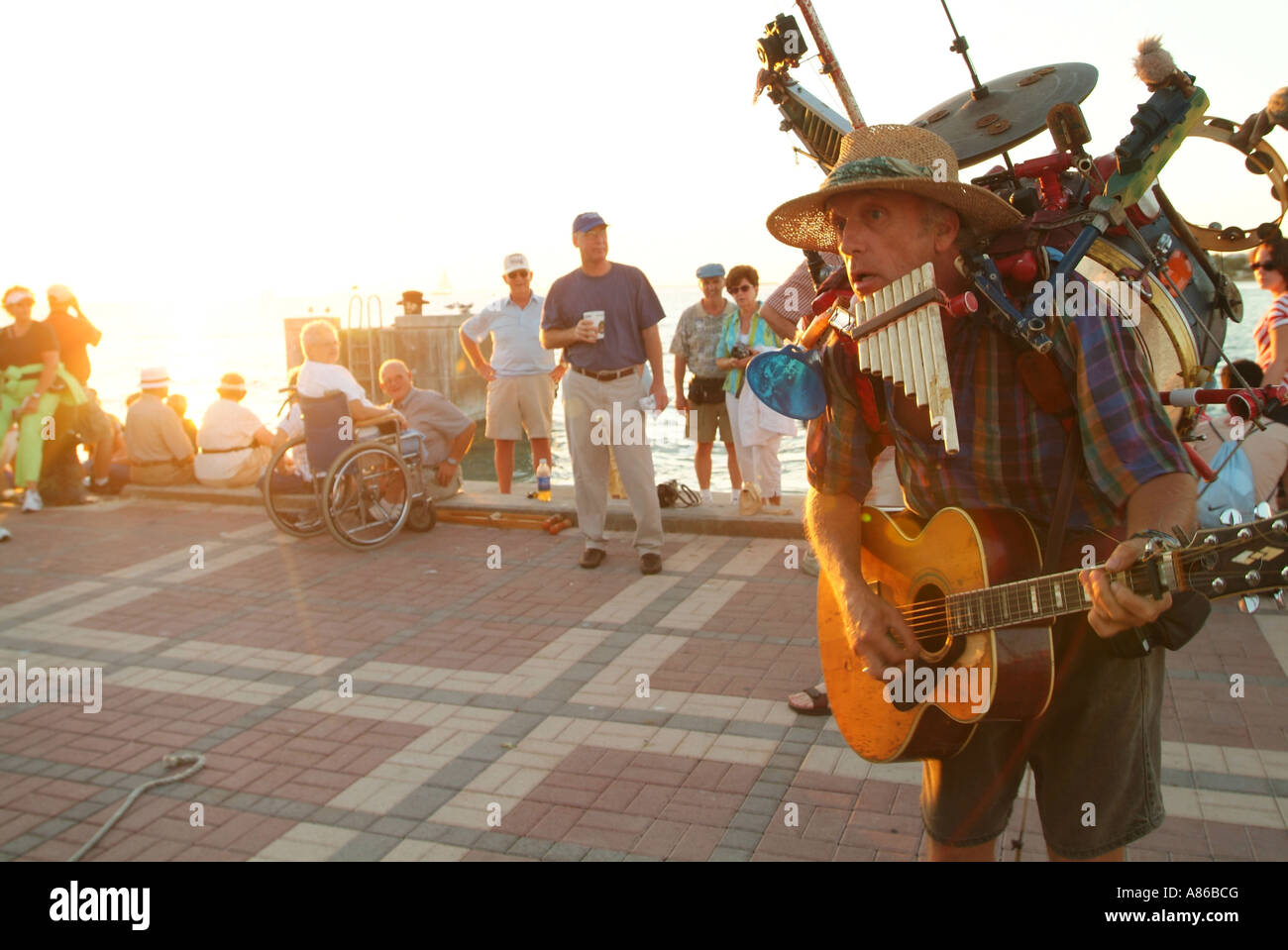 a-one-man-band-performs-at-the-mallory-square-sunset-celebration-key-A86BCG.jpg