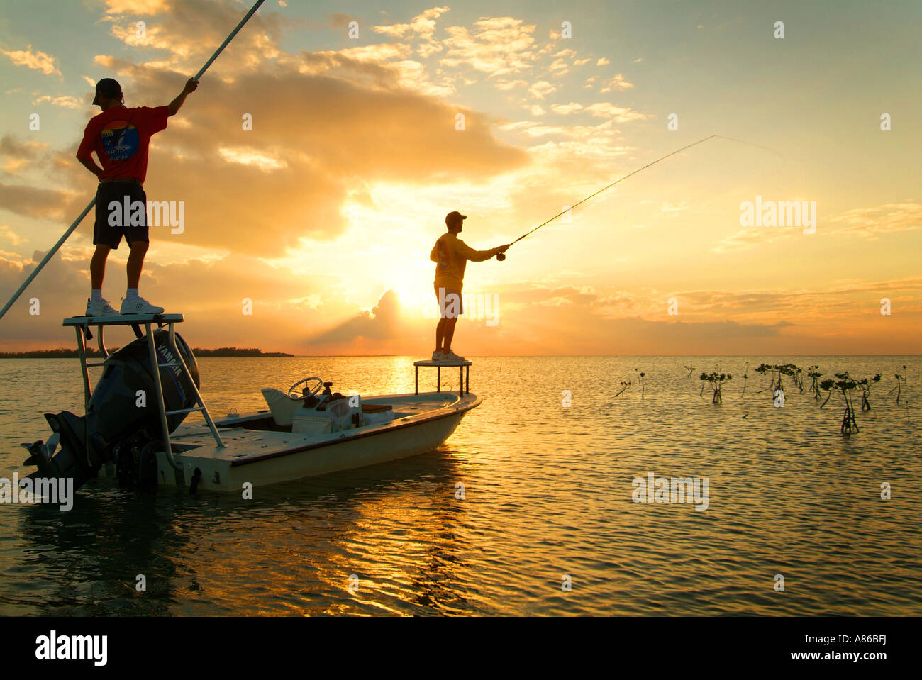 Salt water fly fishing at sunset for bone fish in the Upper Florida Keys Islamorada Stock Photo