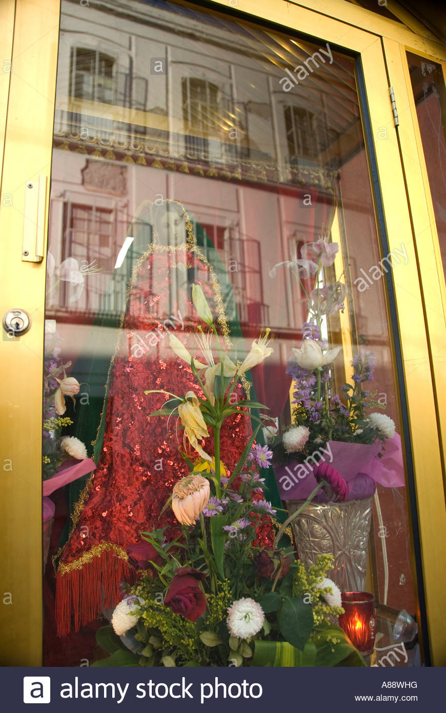 gold case displaying religious christmas decorations and reflection of city homes in glass mexico city historic centre 2007 nr