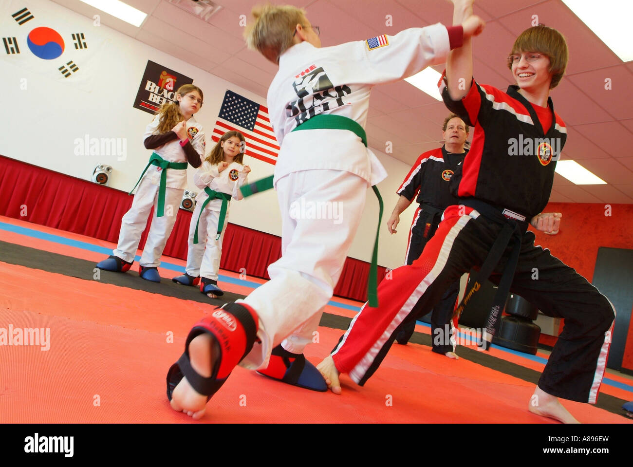 USA A martial arts Tae Kwon Do class at The Black Belt Academy Dominion Valley Virginia Stock Photo